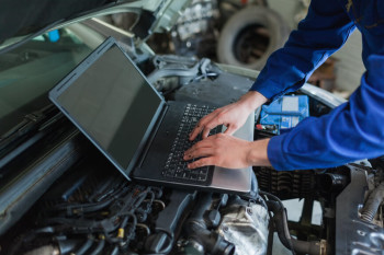 Car Engine and Laptop