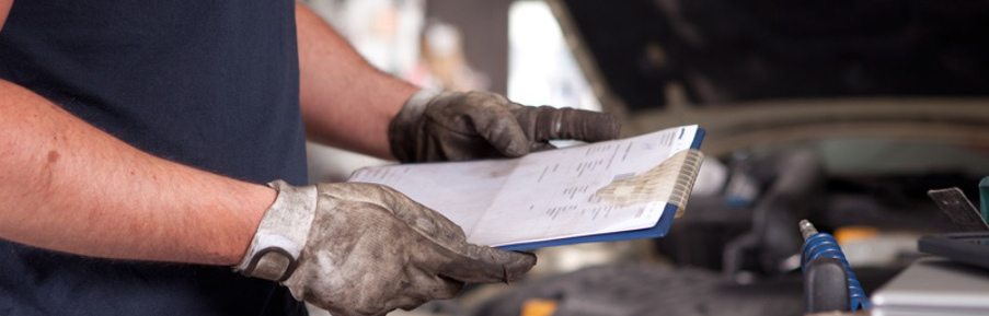 mechanic holding a service order