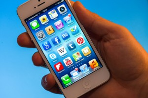 Illuminated iPhone 5 Apps held in hand
