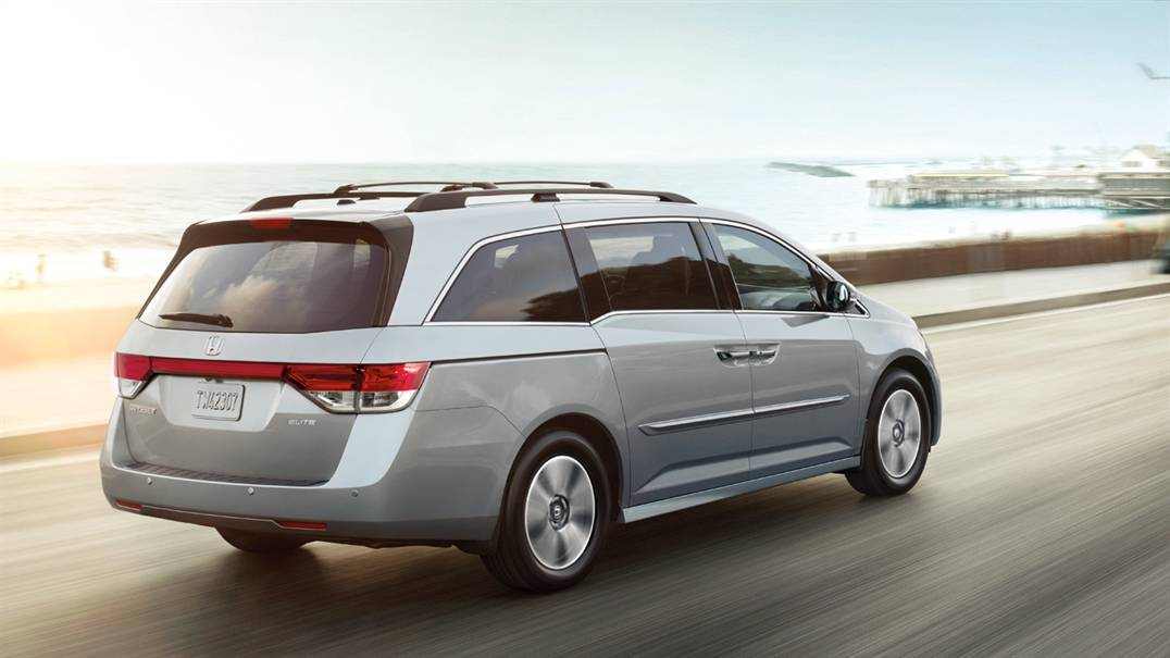 2017 Honda Odyssey driving down a road