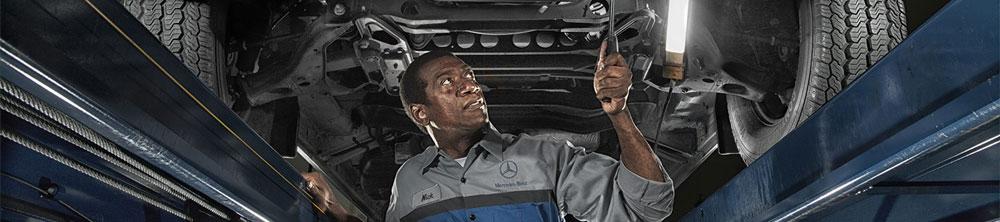 MB Mechanic underneath a vehicle