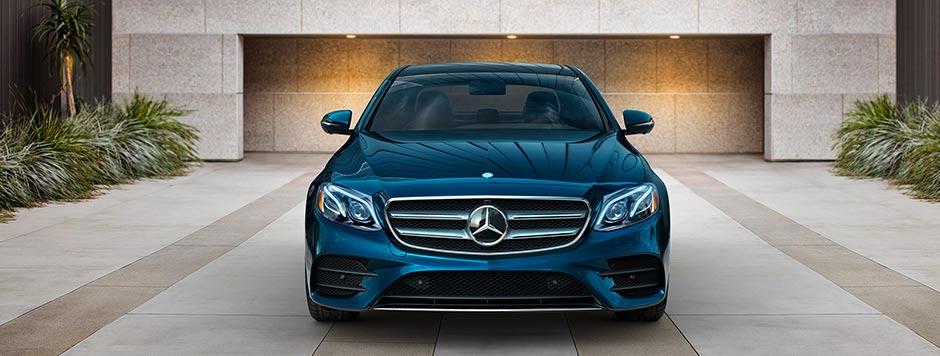 Blue E-Class in Driveway