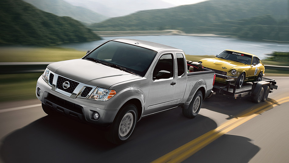 2014 Toyota Tacoma. 2014 Nissan Frontier