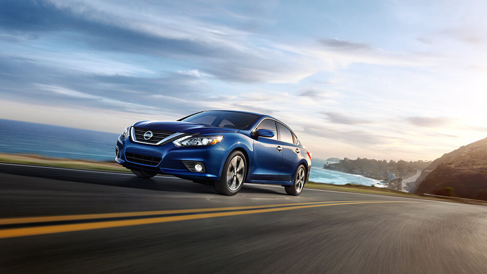blue 2016 Nissan Altima on the road