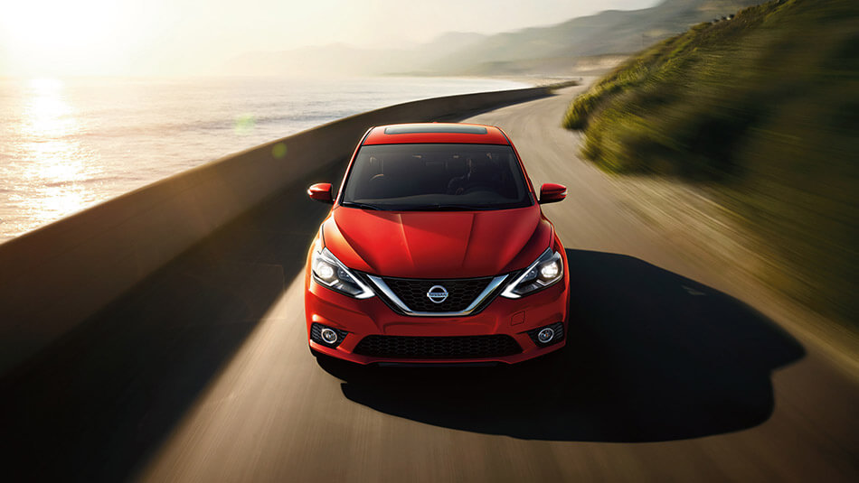 Red 2016 Nissan Sentra on the road