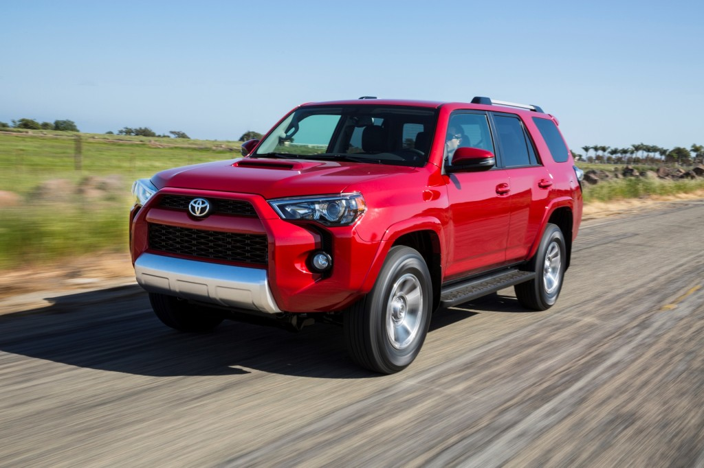 2014 red toyota 4runner driving