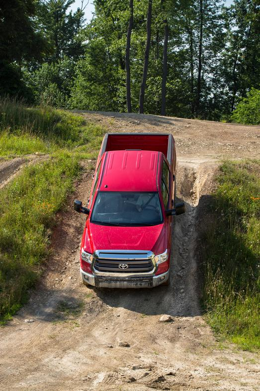 2014 tundra driving down a lil hill red