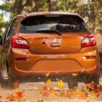 Mitsubishi Mirage driving in the fall