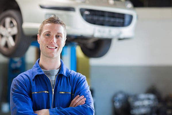 Portrait of confident male mechanic in workshop