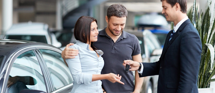 Young couple buys a car