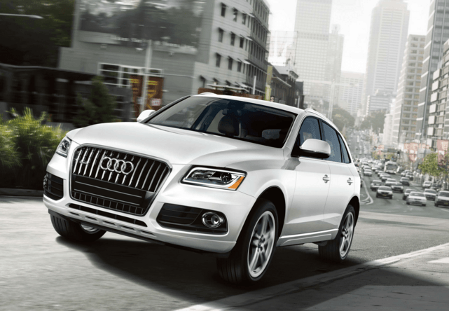 White Audi Q5 Driving in the city