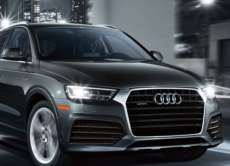 Black Audi q3 driving at night