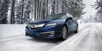 2017 Acura TLX driving down a snowy road